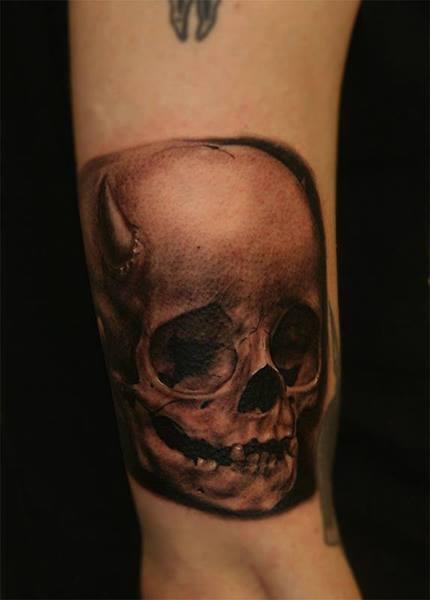 Dark Ink Skull Tattoo On Left Wrist By Anders Grucz