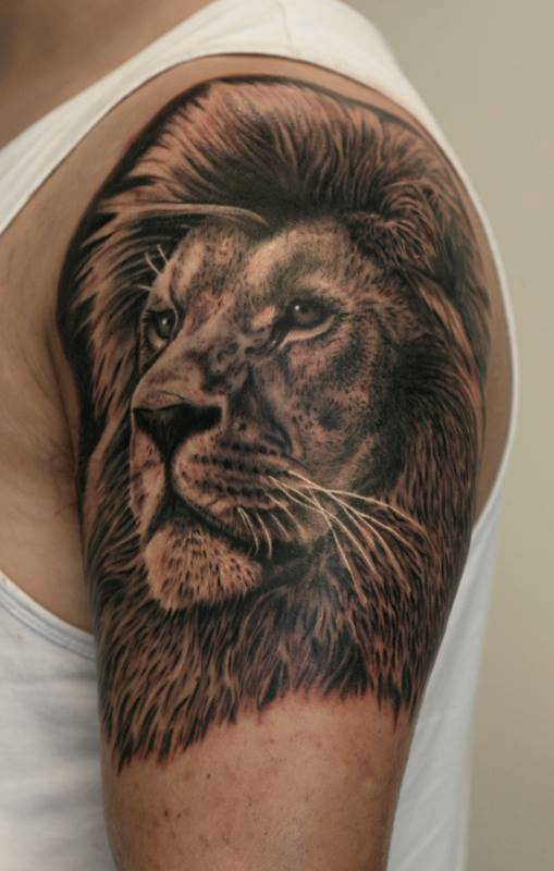 Lion head tattoo on left hand by ab martinez for Lion head tattoo