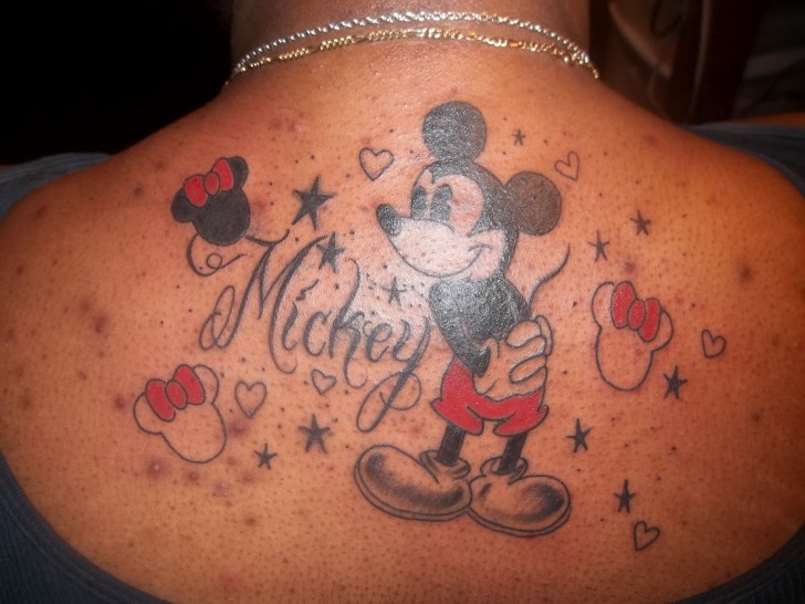 mickey mouse tattoo on upper back. Black Bedroom Furniture Sets. Home Design Ideas