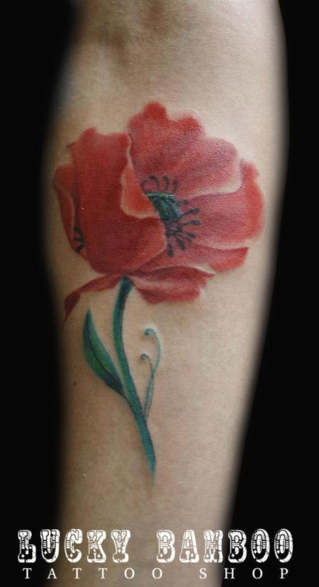 Watercolor poppy flower tattoo on forearm for Forearm flower tattoos