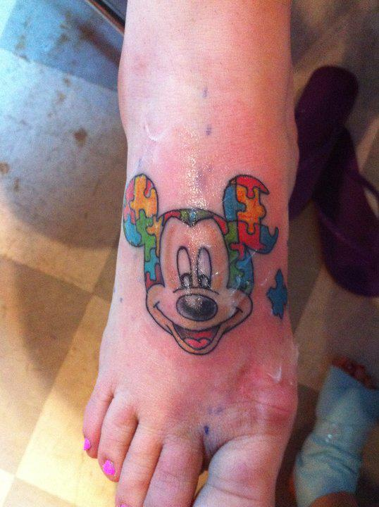 Red And Black Mickey Mouse Tattoo On Left Foot