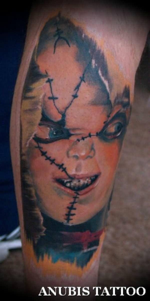 d1afce108 Ripped Skin Horror Chucky Face Tattoo Design For Leg