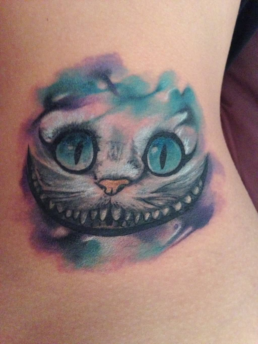 55 awesome cheshire cat tattoos for Watercolor cat tattoo