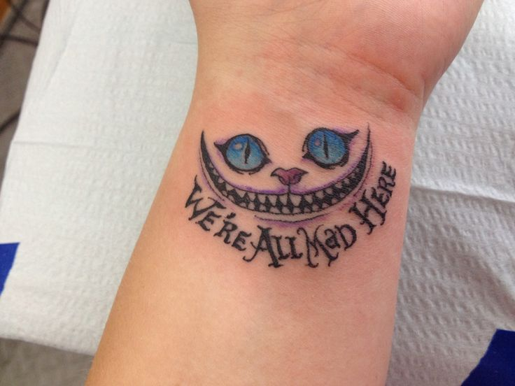 we are all mad here cheshire cat tattoo on left wrist. Black Bedroom Furniture Sets. Home Design Ideas