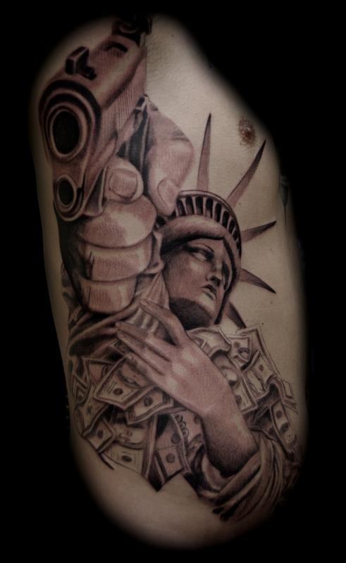 48d38d0512be0 Gangster Statue Of Liberty Tattoo On Man Right Side Rib