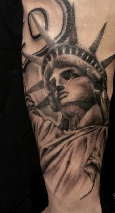 10 statue of liberty tattoo designs. Black Bedroom Furniture Sets. Home Design Ideas