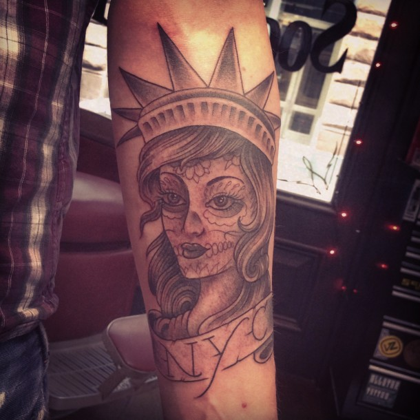 55c4a697947ff Women Statue Of Liberty Tattoo On Forearm