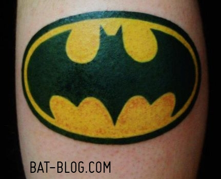 Yellow And Black Batgirl Symbol Tattoo Design