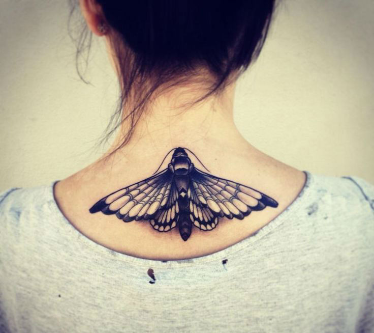 Black Ink Moth Tattoo On Girl Back Neck