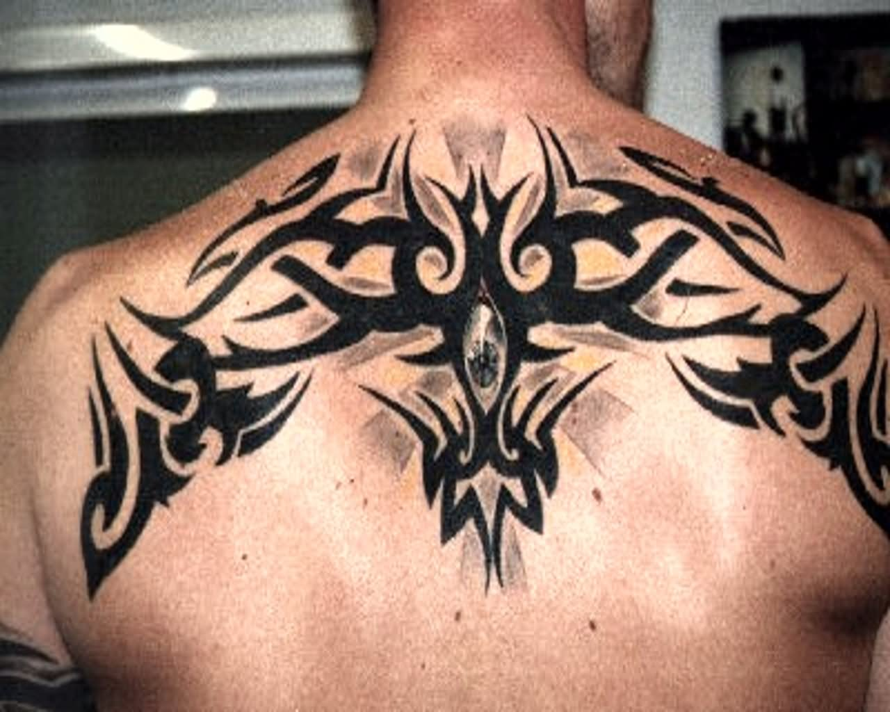 Tribal-Tattoos Black-Tribal-Design-Tattoo-On-Man-Upper-Back
