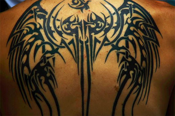 22 famous tribal back tattoos for Tribal back tattoos