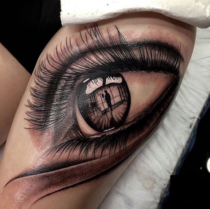 Grey ink realistic eye tattoo on left thigh by dimitar for Eye tattoos designs