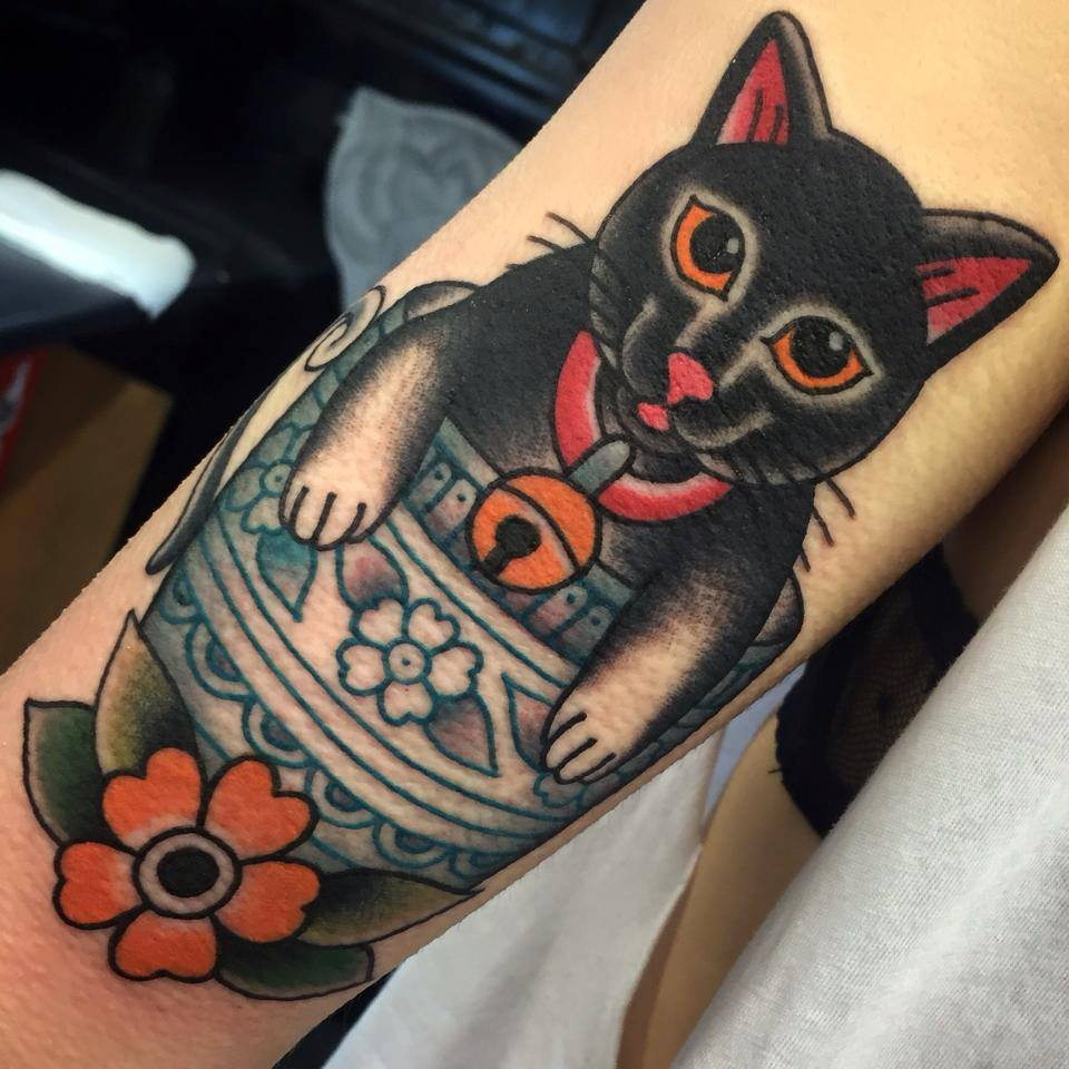 Traditional black cat tattoo on arm for Black cat tattoos