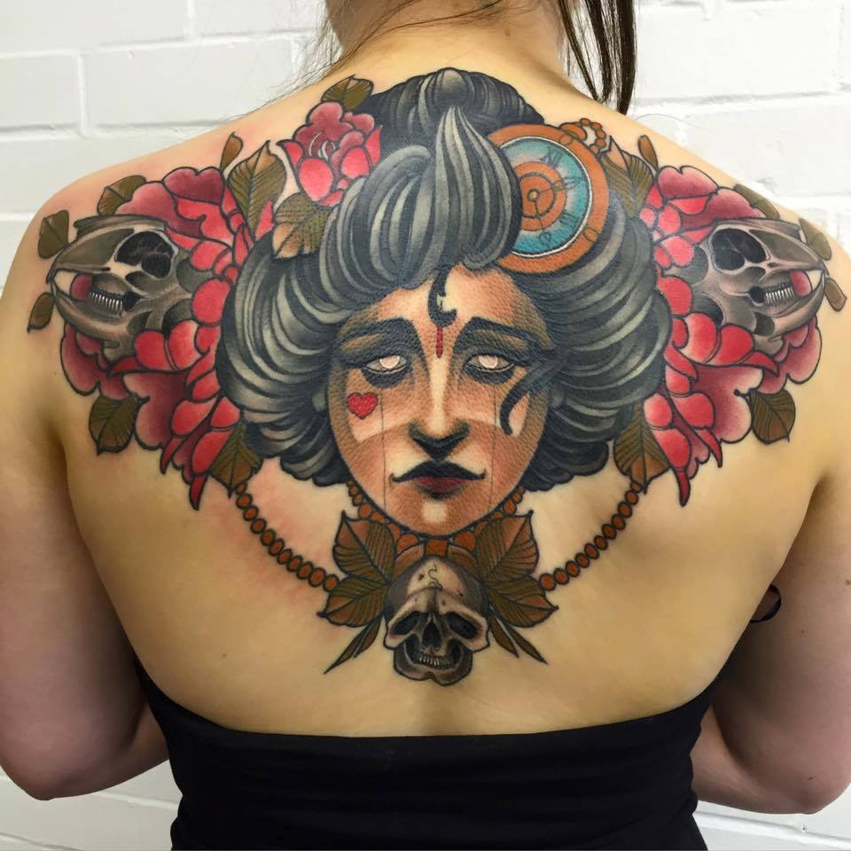Traditional Tattoo On Girl Upper Back by Best UK Tattoo Artist