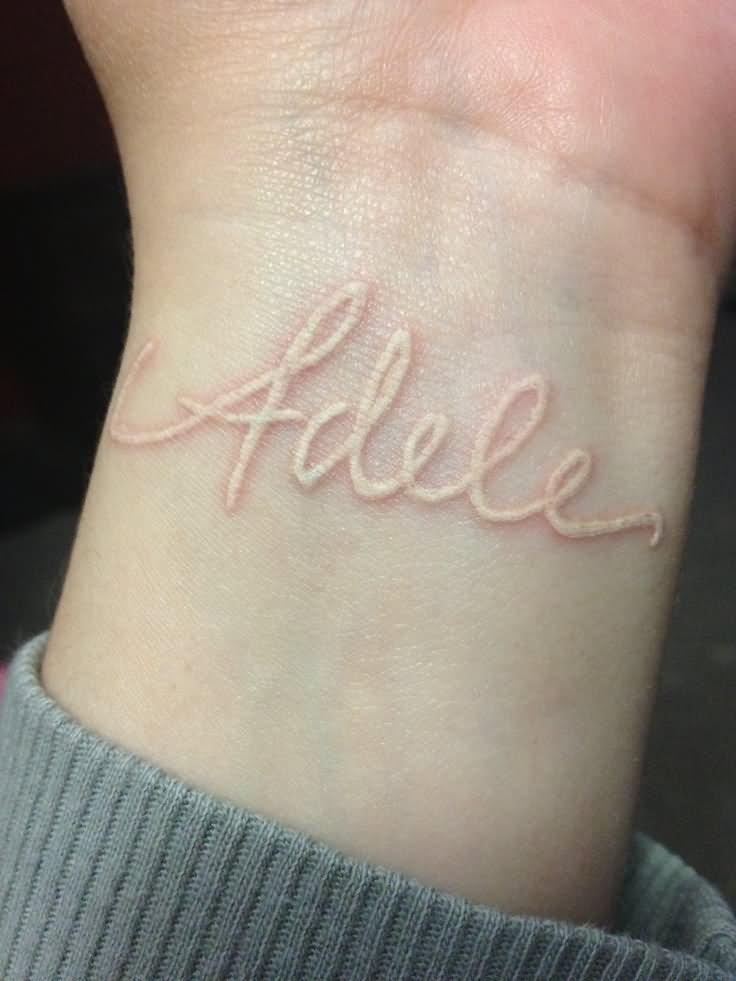 White Ink Adele Name Tattoo Design For Wrist