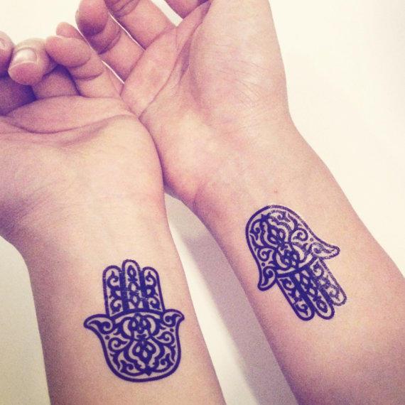 Black Hamsa Tattoo On Both Wrist