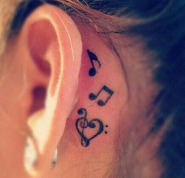 Black heart treble clef with music knots tattoo on left for Heart tattoo behind ear