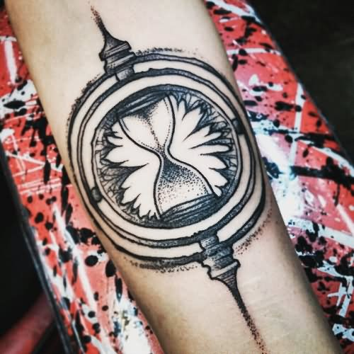 Phoenix With Time Turner And Snitch Tattoo On Left Side
