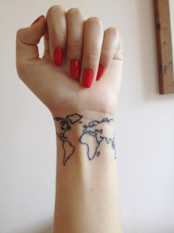 Cool World Map Tattoo On Girl Wrist