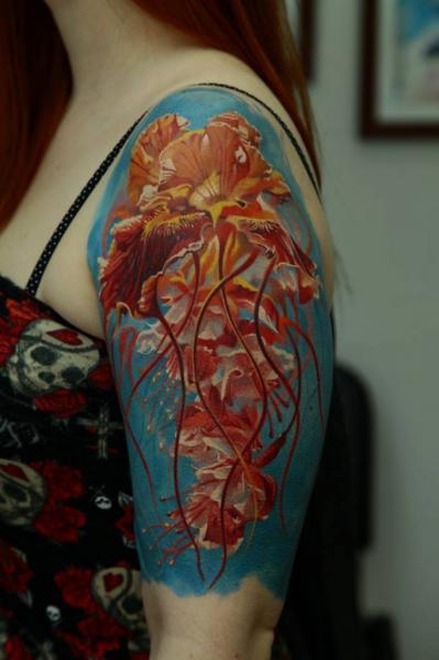 Girl with beautiful jellyfish tattoo on half sleeve for Beautiful half sleeve tattoos