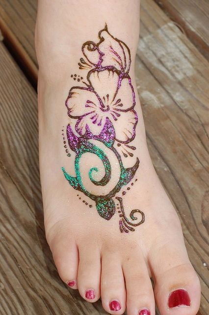 Tribal Flower And Turtle Tattoo On Right Foot