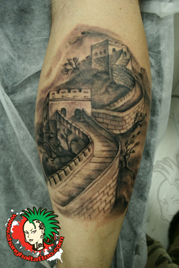 Lioness With Great Wall Of China Tattoo Design For Side Rib
