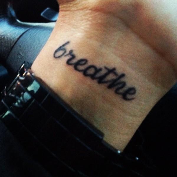 Just Breathe Lettering Tattoo On Wrist: 25+ Just Breathe Wrist Tattoos