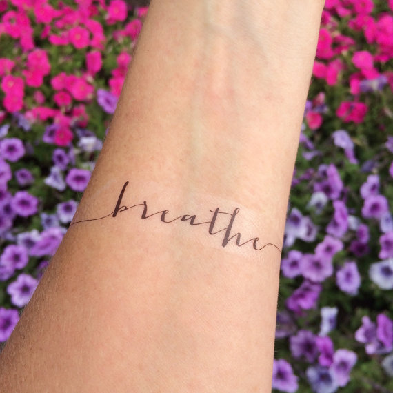Just Breathe Lettering Tattoo On Wrist: Lovely Small Horus Eye With Lettering Tattoo On Forearm