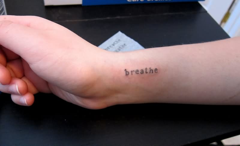 b09ae915863a3 Little Breathe Lettering Tattoo On Right Side Wrist