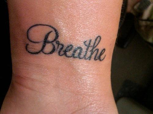 fb1414bbb098e Simple Breathe Lettering Tattoo Design For Wrist