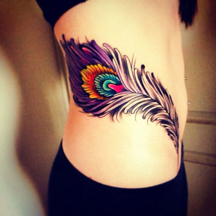 387e03ef7 Attractive Feather Tattoo On Girl Right Hip