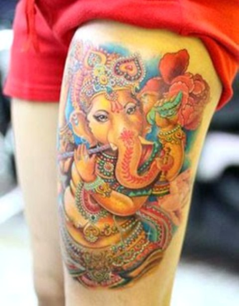 Beautiful color ink ganesha tattoo on left thigh for Colorful thigh tattoos