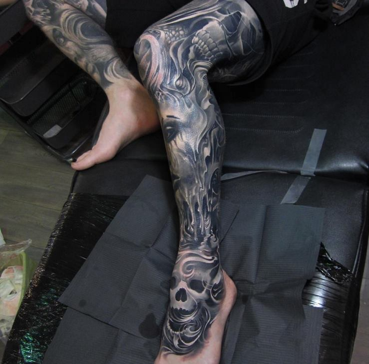 Black and grey horror skull tattoo on leg for Skull leg tattoos