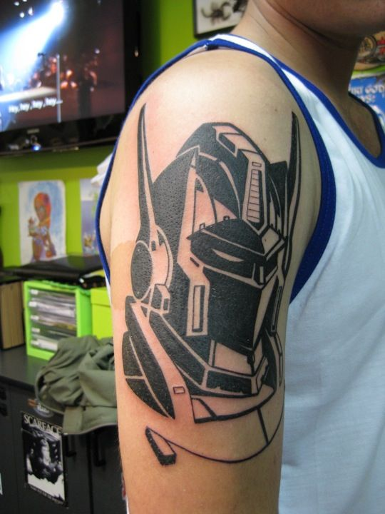 40 wonderful transformer tattoos. Black Bedroom Furniture Sets. Home Design Ideas
