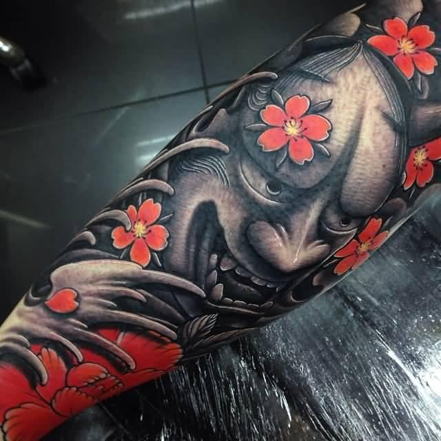 Japanese Flowers And Black Hannya Mask Tattoo On Sleeve