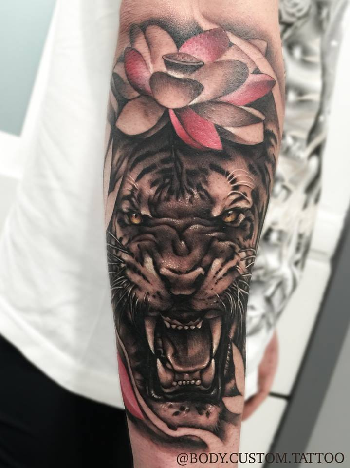 Lotus Flower And Angry Tiger Face Tattoo On Forearm