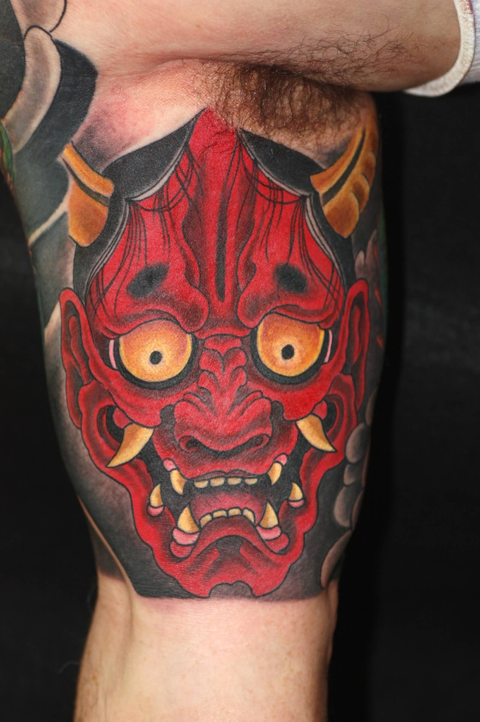 Red hannya tattoo on bicep by alexander rusty for Japanese mask tattoo