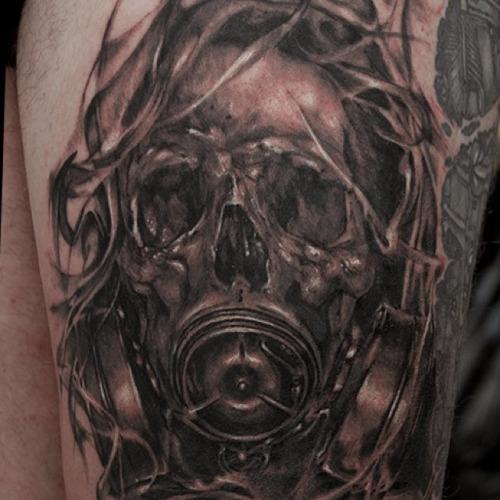 Black Ink Skull Gas Mask Tattoo On Left Thigh