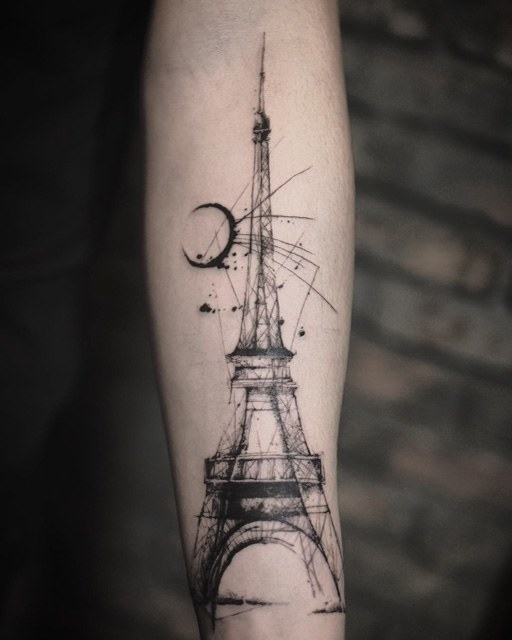 Eiffel tower tattoo on left forearm by carpet bombing