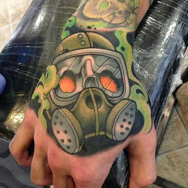 25aab14bb6af3 Green Ink Gas Mask Tattoo On Right Hand