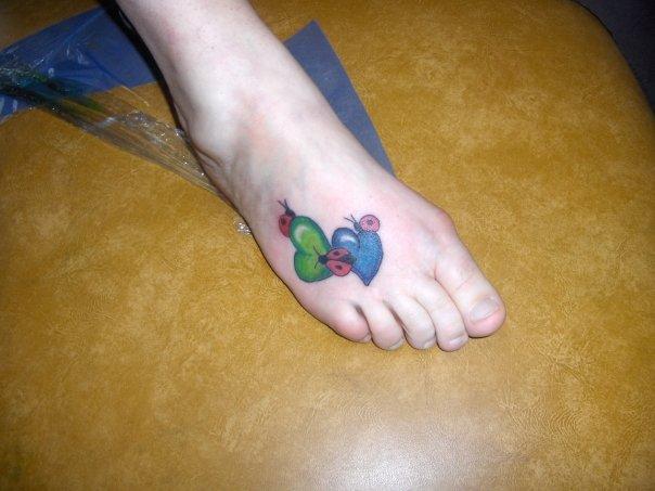 43 incredible ladybug and flower tattoos for Ladybug heart tattoos