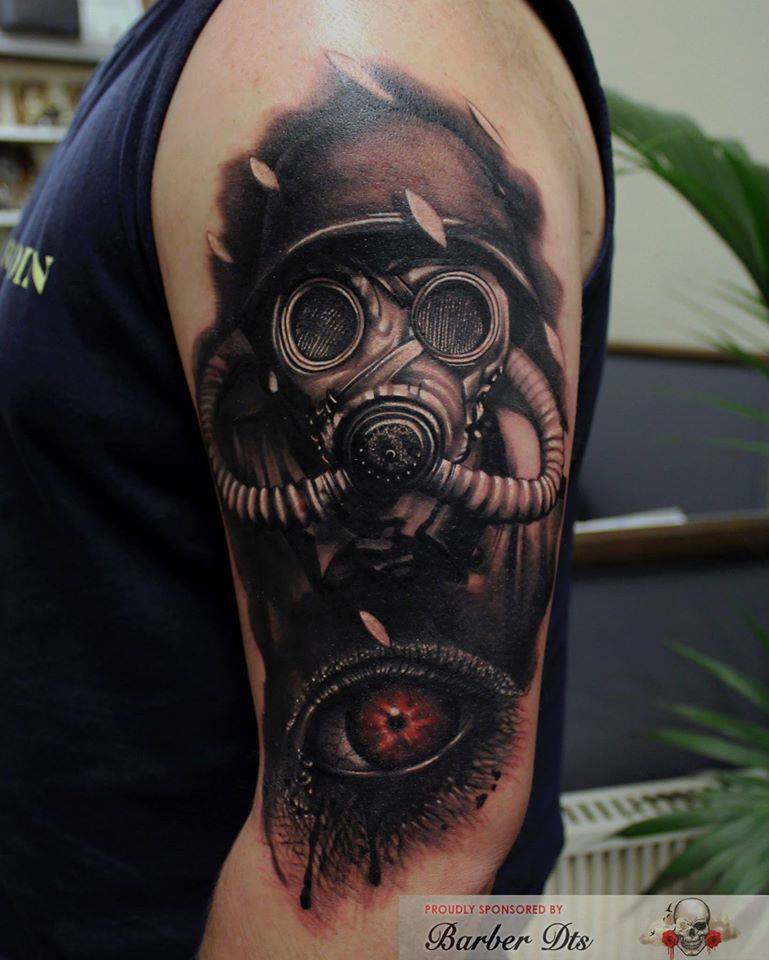 Crying Eye And Gas Mask Tattoo On Left Half Sleeve