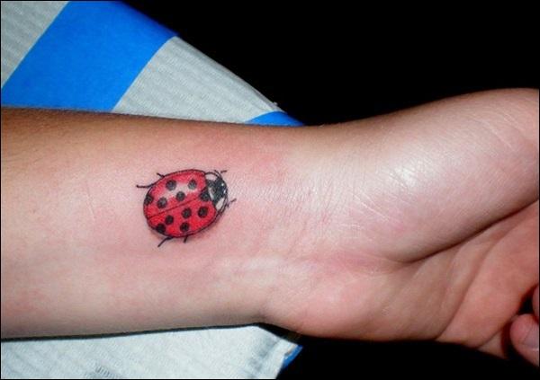 28 awesome colored ladybug tattoos for Ladybug heart tattoos