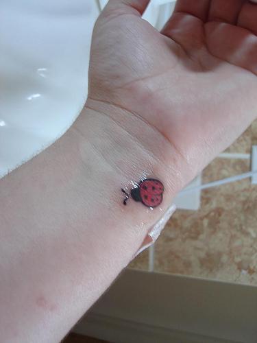 25 Attractive Ladybug Tattoos On Wrist