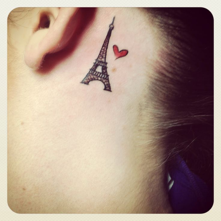Tiny red heart and eiffel tower tattoo behind the ear for Heart tattoo behind ear