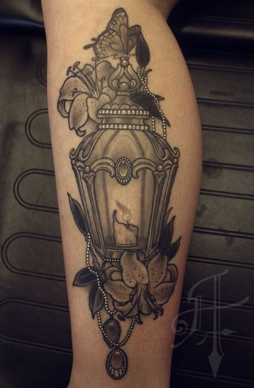 Grey Ink Lily Flower And Candle Lamp Tattoo On Leg