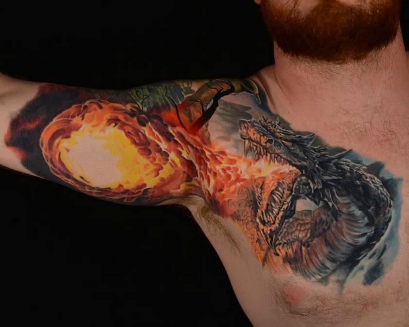 56c2f5f127977 3D Fire Dragon Tattoo On Man Chest And Bicep by Daniel Rocha
