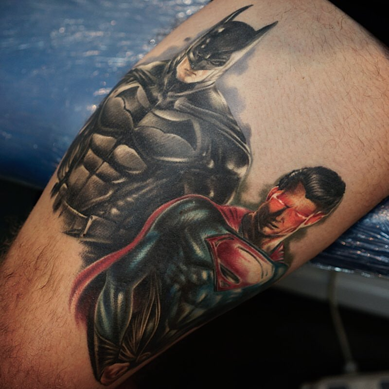 Batman And Superman Tattoo On Leg