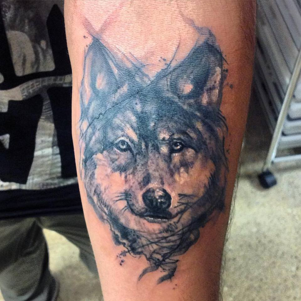 8ffe3a724ad2d Black And Grey Wolf Head Tattoo On Left Forearm by Gutti Canvasink
