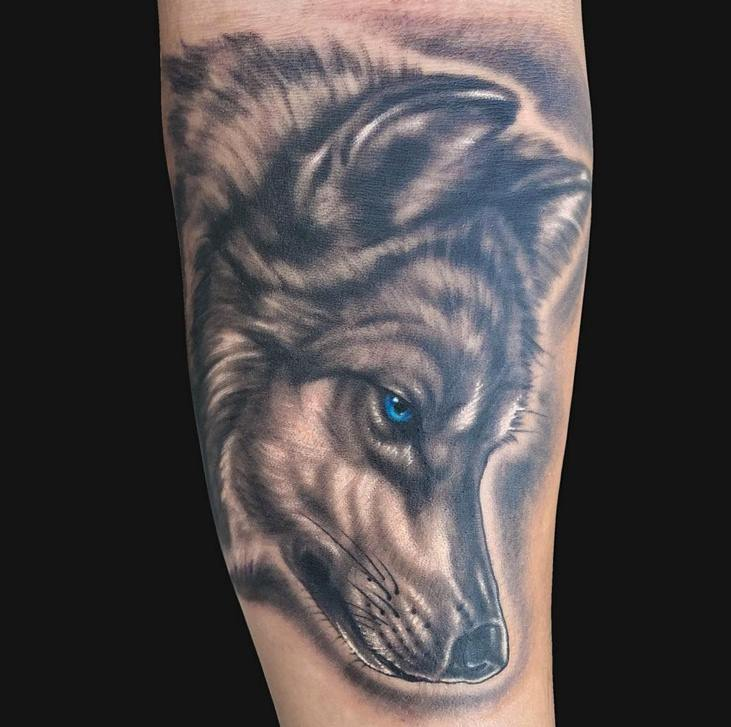 Blue eye wolf head tattoo on arm by marc durrant for Wolf head tattoos